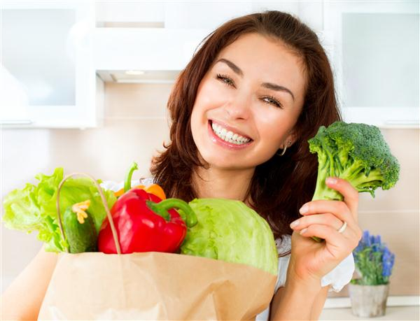 Happy Young Woman with vegetable